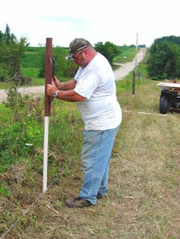 Driving PasturePro posts with t-post driver, building fence